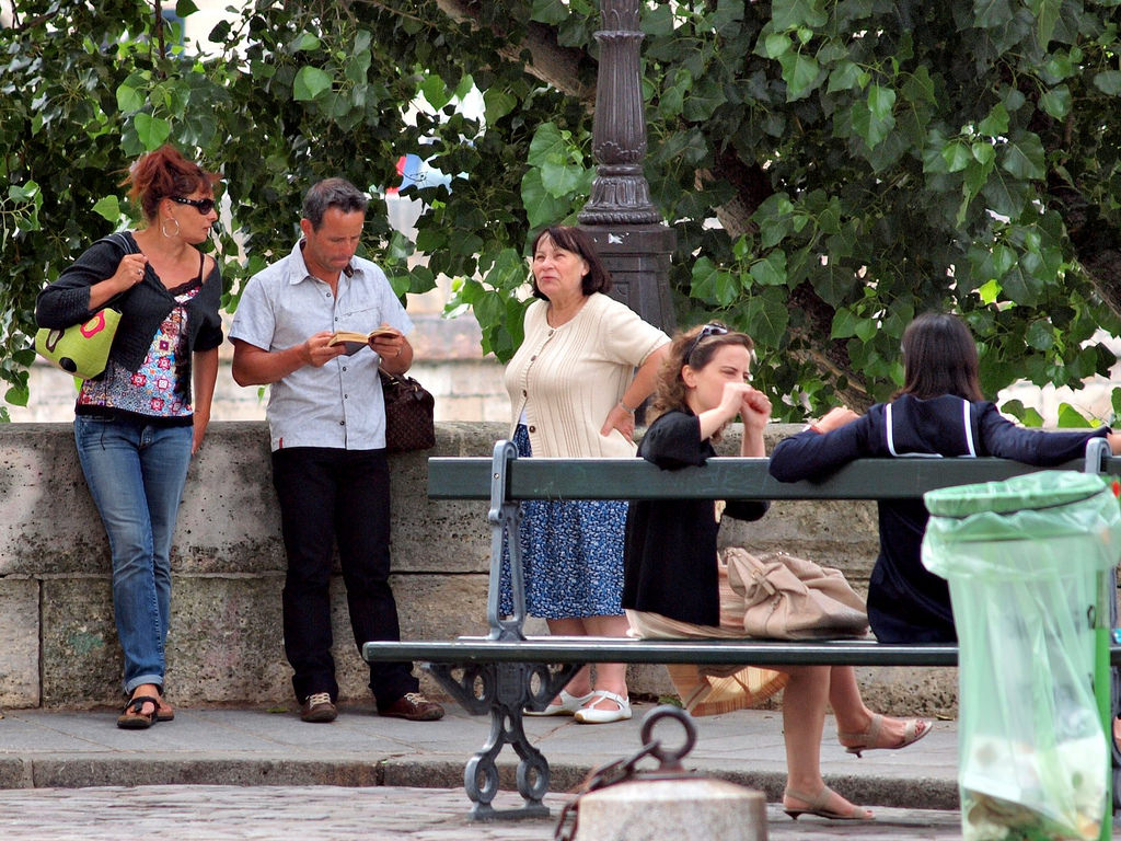 tourists checking their guidebook in paris france