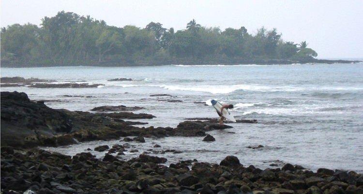 1024px-Surfer_Entering_at_Banyans
