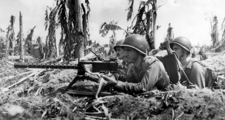 Three_Marines_and_their_machine_gun_on_Guam